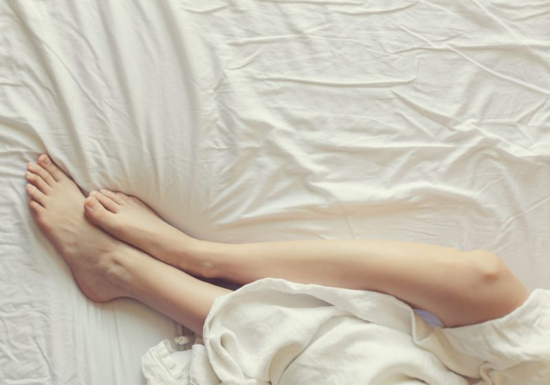 Fortune Telling With Your Cycle woman laying in bed | The Sublime Woman