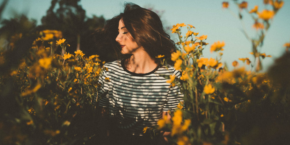 Fragrances for Health And Beauty beautiful woman with flowers field of sunflowers   The Sublime Woman