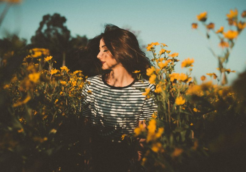Fragrances for Health And Beauty beautiful woman with flowers field of sunflowers | The Sublime Woman