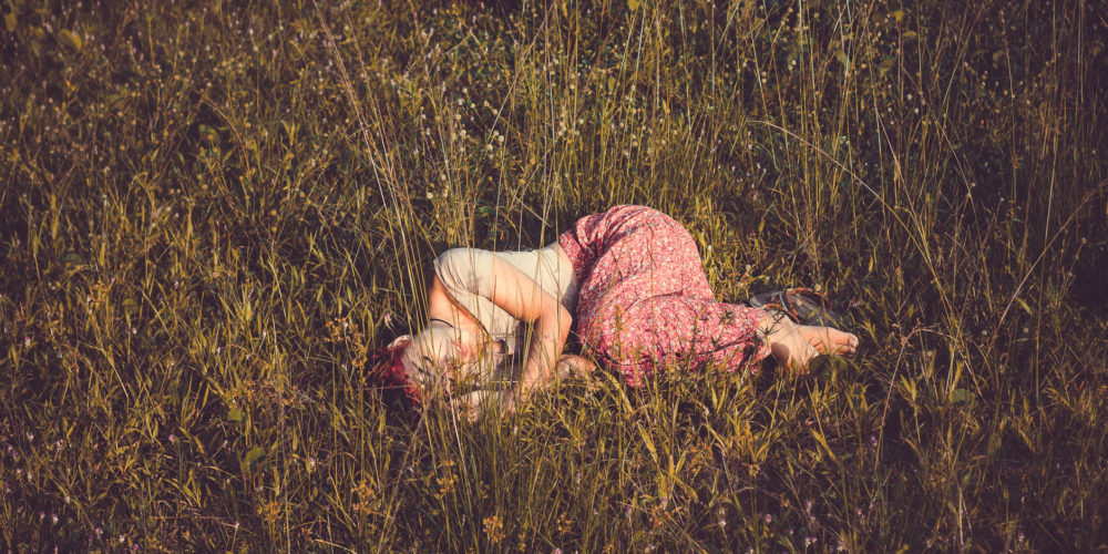 Feminine Rest Relaxing like a Woman beauiful woman laying in the field of flowers | The Sublime Woman