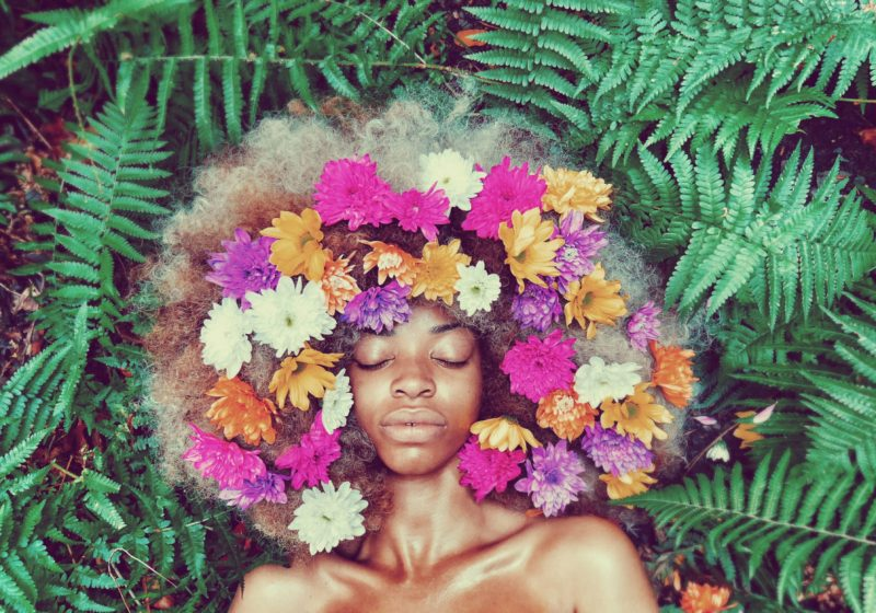 Overcoming Hurt Feminine Rituals beautiful black woman with flowers | The Sublime Woman