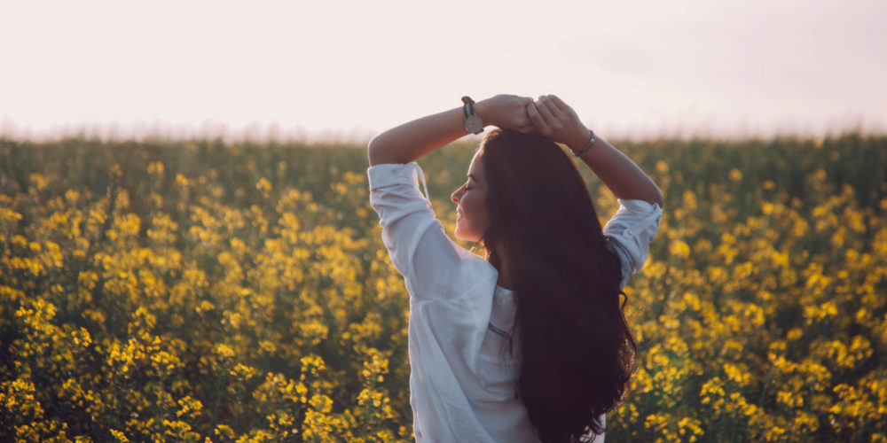 Woman's Dignity beautiful woman with long hair in the field of wild flowers | The Sublime Woman
