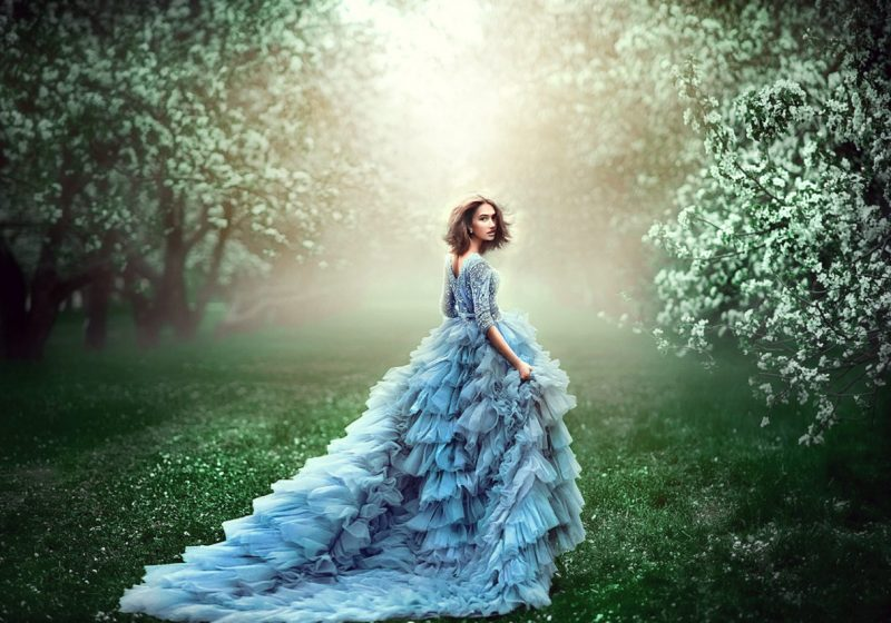 Practice Woman's Vishuddha Chakra Healing beautiful woman in blue fluffy dress in the woods   The Sublime Woman