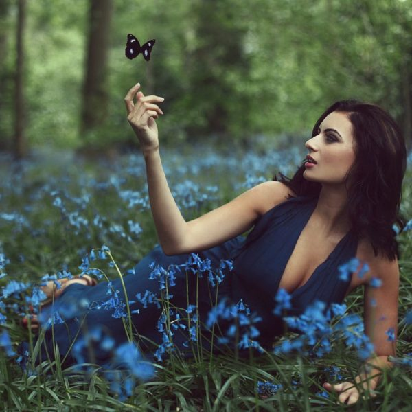 Practice: Woman's Ajna Chakra Healing beautiful woman in dark blue dress in forest and flowers | The Sublime Woman