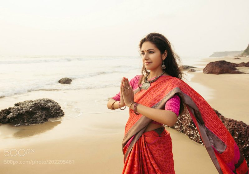 Mantras for Women beautiful woman in indian dress praying | The Sublime Woman